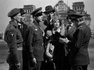 The cast of Berlin Express, seen in front of the real rubble of post-WWII Germany.